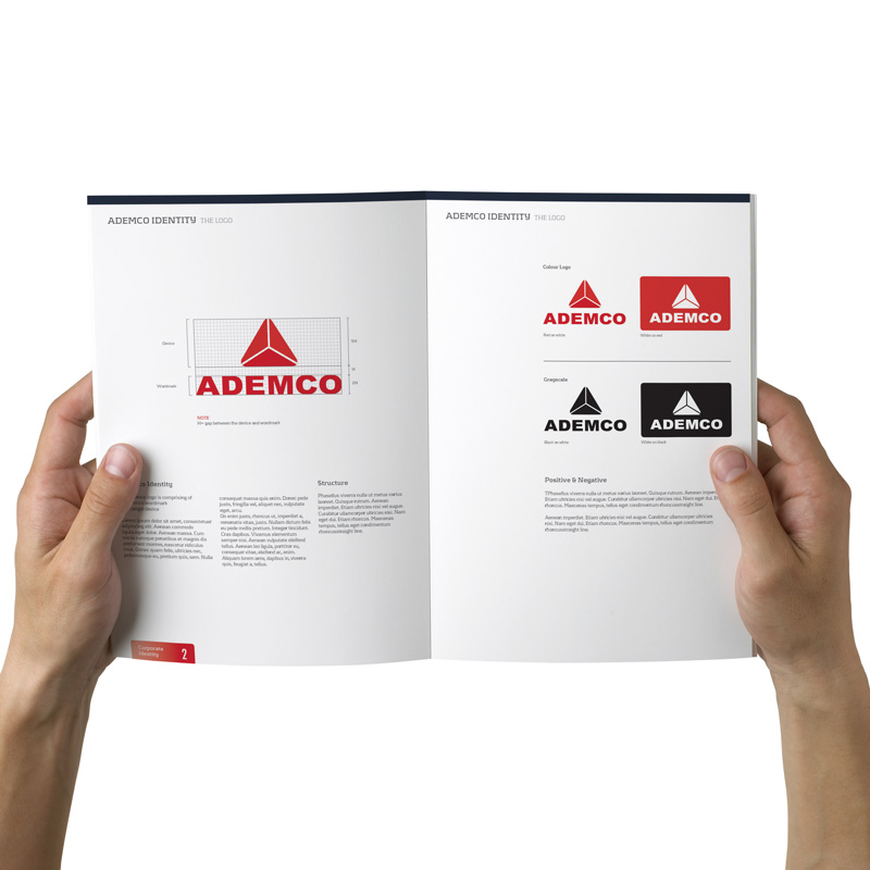 Inside layout of corporate identity manual for Ademco, designed by Spinnaker360.